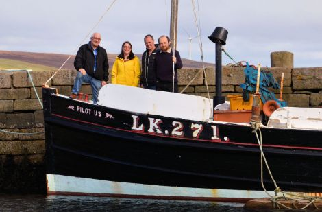The Shetland Boat Week organising team on board the Pilot Us (left to right): Brian Wishart, Emma Miller, John Henderson of main sponsor Ocean Kinetics, and Dr Ian Tait of Shetland Museum and Archives.
