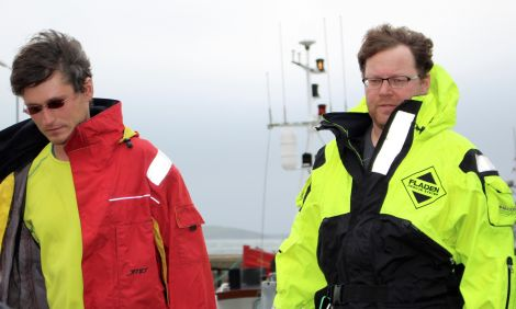 Miracle skipper Matusz Cwiklinske (left) with fellow Polish sailor leaving Scalloway after their rescue on Thursday.