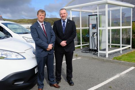 NHS Shetland chief executive Ralph Roberts and SIC leader Gary Robinson pictured at the Gilbertson Park's electric vehicle charging point last month. There are now a dozen points throughout the isles. Photo courtesy of SIC.