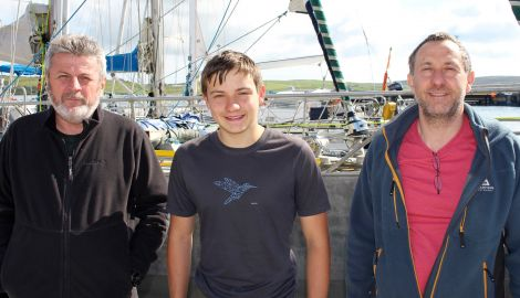 The Northabout crew visiting Shetland ahead of their circumpolar journey include (from left) skipper Nikolay Litau, Benjamin Edwards and his father Steve Edwards.