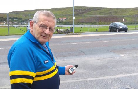 Resident Sandy MacMillan with his decibel measuring device - Photo: Chris Cope/ShetNews