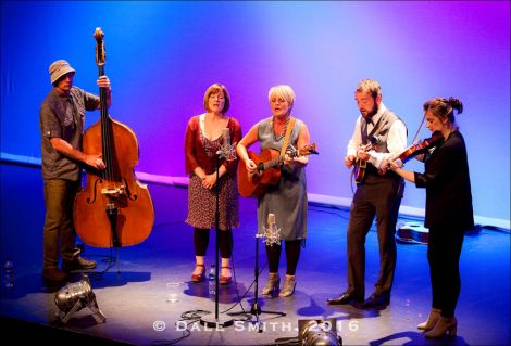 From left: bassist Graham Malcolmson, singers Sheila Duncan and Freda Leask, mandolinist Lewie Peterson and fiddler Lois Nicol around a single mic at Mareel on Saturday evening. Photo: Dale Smith