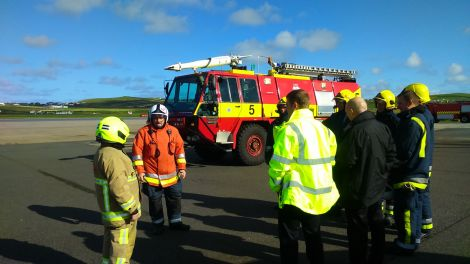 Andrew Dane meeting the fire crew at Sumburgh Airport on his visit to Shetland.