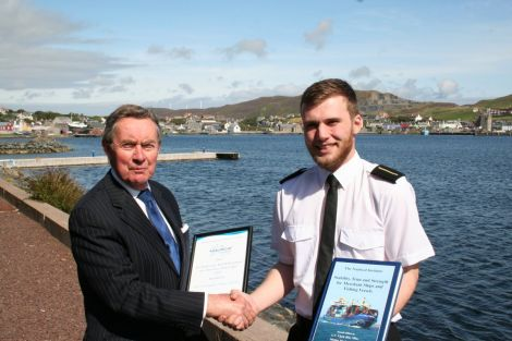 Ross Sinclair receiving his award from Captain George Sutherland.