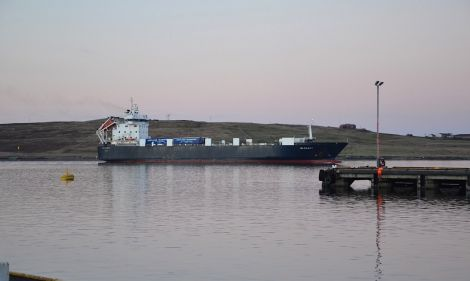 The NorthLink cargo boat Hildasay leaving Lerwick harbour.