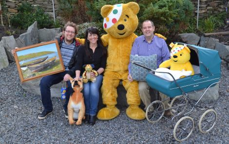BBC Radio Shetland presenters Daniel Lawson, Jane Moncrieff and John Johnston with Pudsey Bear, the Children in Need mascot.