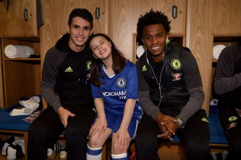 12 year old Macy pictured with Chelsea first team stars Oscar and Willian.