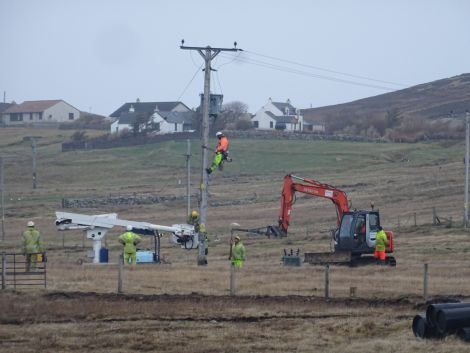 Engineers working to restore power to Bressay on Saturday morning. Photo: John Bateson