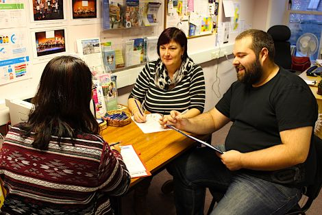 Kathleen Williamson (centre) and Neil Pearson with a client at the Market House offices of VAS Volunteering - Photo: Louise Thomason