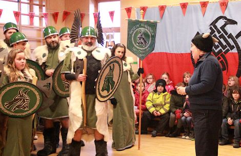 Welcoming the jarl's squad to Nesting primary school headteacher Kate Coutts reveals that this is also her 25th Up Helly Aa anniversary since working as a teacher - all other photos: Hans J Marter/Shetland News