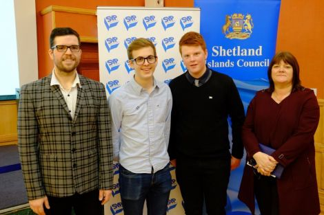 Newly elected MSYPs Sonny Thomason (second from left) and Charlie Haddon (third from left) with Martin Summers of Shetland Islands Council (left) and deputy returning officer Anne Cogle. Photo: SIC.