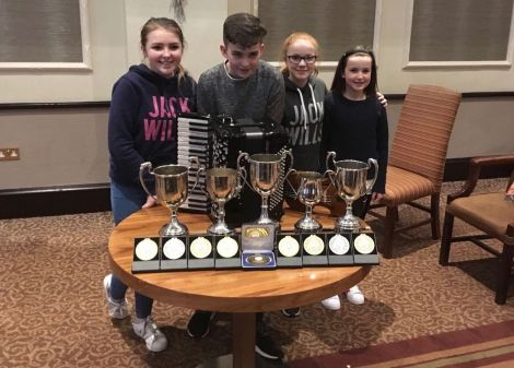 Shetland's young prize winners with their impressive trophy haul.