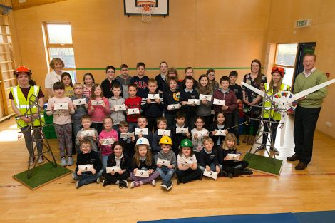 Pupils from the Nesting and Sandness primary schools are being joined by Shawney Henderson of Edinburgh Science Festival (front row left), Jenny Wink of Shetland Gas Plant (back row left), Lizzie Leask of Total E&P UK (back row right), Sophie McCabe of Edinburgh Science Festival (front row right), and Shetland MSP Tavish Scott.