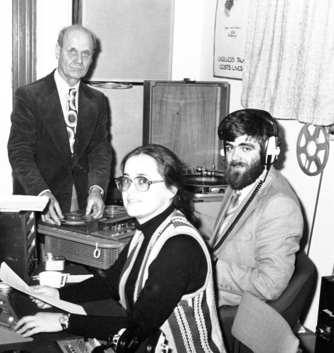 Suzanne Gibbs and Jonathan Wills broadcasting from the Brentham House studio. BBC engineer Cecil Watkinson (left) came out of retirement to give technical support to the new radio station. Photo: Jonathan Wills collection