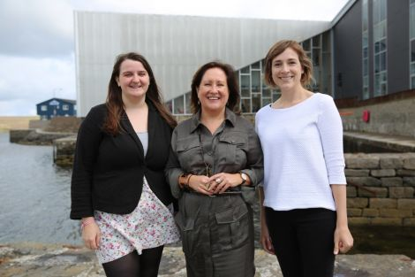 Wordplay curator Karen Cunningham (centre) pictured with Cara McDiarmid (left) and Floortje Robertson (right) of Shetland Arts. Photo: Jenny Leask.