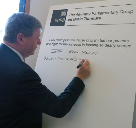 MP Alistair Carmichael signing the brain tumour pledge earlier this week.