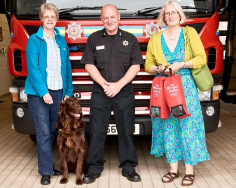 Pheona Horne, Loki the dog, Lerwick station manager Graham Reid and Tricia Brown. Photo: Chris Brown.