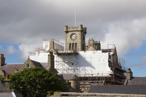 With work progressing on the stonework at Lerwick Town Hall, the refurbished clock tower is now visible again. Photo: Shetland News/Hans J. Marter.