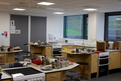 There are three kitchen spaces in the new school for teaching.