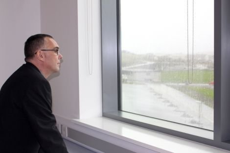 Lerwick North councillor John Fraser looking out onto the Clickimin running track from an art and design room.