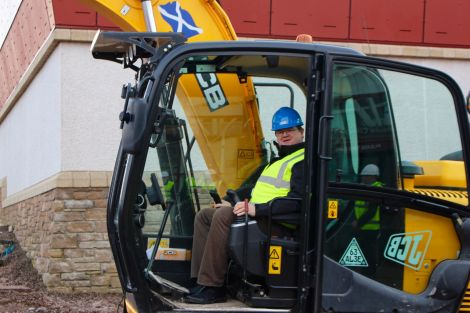 SRT chairman Bryan Leask trying out a digger. Photo: Chris Cope/Shetland News