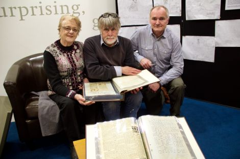 Looking through the minutes are (left to right): former Althing chairwoman Florence Grains, Shetland archivist Brian Smith and current Althing chairman Andrew Halcrow. Photo: Hans J Marter/Shetland News