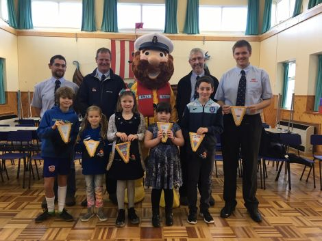Pictured alongside lifeboat crew Darren Harcus, Gareth Geddes, Stormy Stan, Peter Kerr and Iain Derbyshire are children, from left to right: Torquil Mackenzie (P7), Julia Strachanowska (P4), Lois Tait (P5), Lily Heder (P2), Luke Hackett (P6). Missing from the photo are Zack Arthur (P3) and Isabelle Moss (P7).