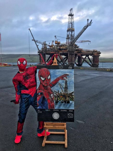 Spiderman safely on land with the painting in front of the Buchan Alpha platform. Photo: Kristof Onhausz