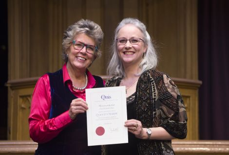 Clare Stiles (right) accepting her award from guest attendee Prue Leith, who is a judge on the Great British Bake Off. Photo: Lesley Martin Photography/QNIS