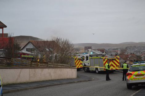 Sandyloch Drive was cordoned off while fire engines attempted to bring a house fire under control on Monday morning. Photo courtesy of BBC Radio Shetland.