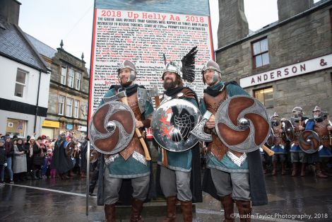 Guizer jarl Stewart Jamieson with his two sons Shane and Haydn in from of the Bill at Lerwick's Market Cross.