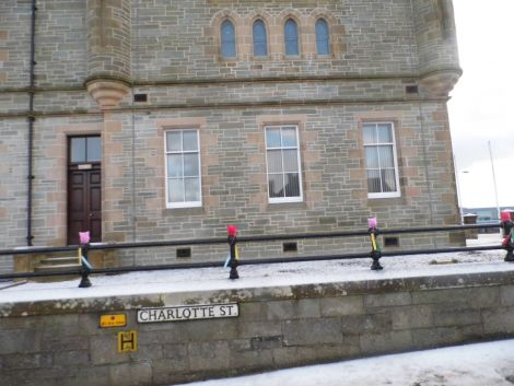 "The crafted ""pussy hats"" were placed on the railings around Lerwick Town Hall in the small hours over the weekend."