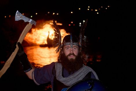 'An honour to represent the festival', Nesting & Girlsta guizer jarl with his burning galley on Friday night. Photo: Chris Brown
