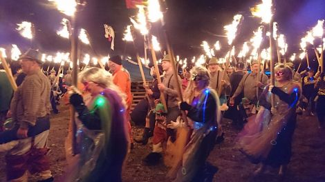 Guizers circling the galley prior to the burning on Friday night. Photo: Kevin Osborn