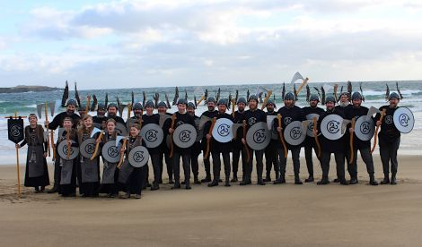 Guizer jarl Aaron Priest with his squad of 20 Vikings and five girls at Norwick beach earlier on Saturday. Photo: Desley Ritch