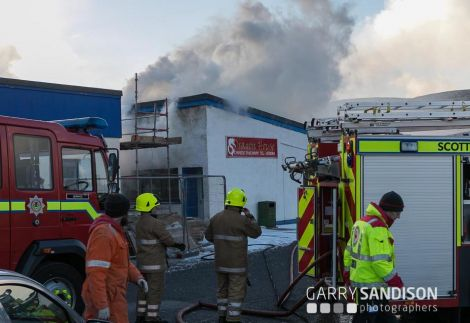 Two appliances from Lerwick responding to the fire in the takeaway. Photo: Garry Sandison