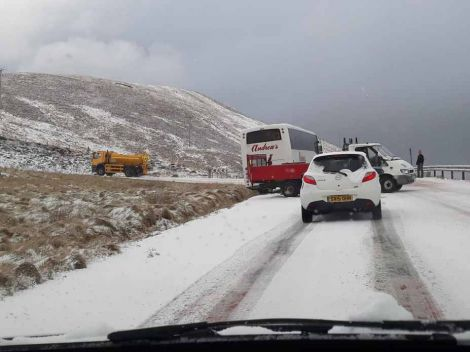 Beverley Lamming took this photo of a school bus after its rear end came off the road while coming out of Scalloway.