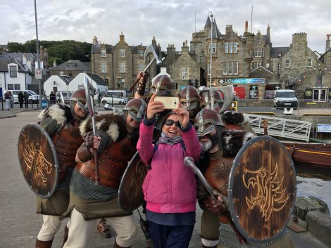 Vikings from Lerwick's Jarl Squad create a lasting impression on passengers and crew from MV Columbus during her maiden call at Lerwick Harbour. Photo: Lerwick Port Authority.