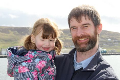 Cooke Aquaculture's David Brown with his daughter who inspired the name of the workboat Vaila Marie.