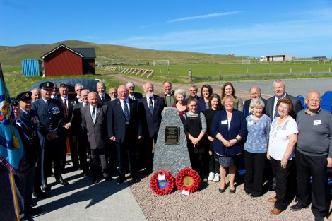 Representatives from the RAF, RAFA, the Reid and Irwin families join Cunningsburgh History Group and the day's speakers. Photos: Chris Cope/Shetland News