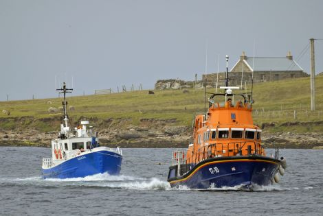 Charlie Upphray's picture of the lifeboat towing the workboat Koada.