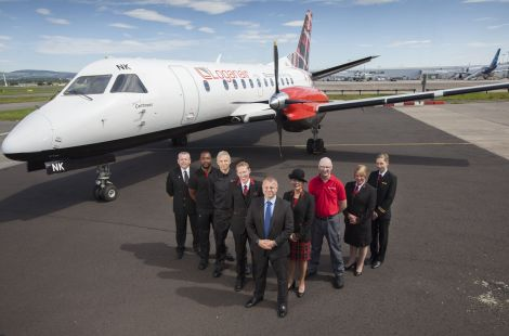 "Loganair managing director Jonathan Hinkles (front) said it had been a ""challenging"" year."