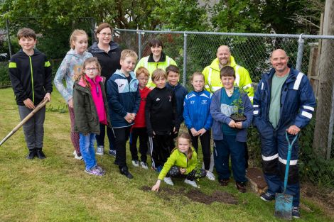 From back left to right: Bell's Brae eco committee teacher Sophie Thouless, Lerwick Port Authority HSEQ assistant Amy Inkster and Stuart Wadley, Shetland Amenity Trust woodlands foreman Paul Goddard with Bell's Brae P2-P7 school pupils. Photo: John Coutts