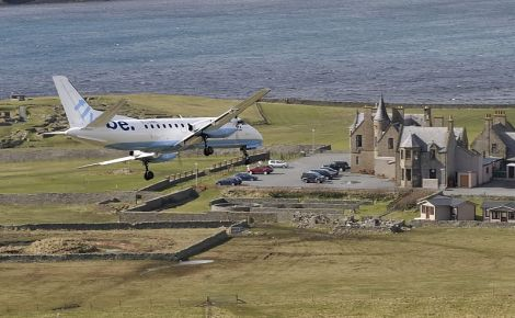 A Flybe plane operated by Loganair flying into Sumburgh. Photo: John Moncrieff