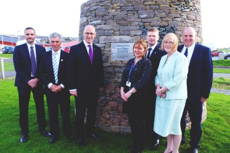 John Swinney (third from left) with (L-R) Trevor Smith and James Armitage, from the AHS project team, head teacher Valerie Nicolson, council convener Malcolm Bell, children's services director Helen Budge and George Smith, chairman of the SIC's education and families committee. Photo: SIC