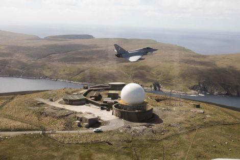 A Typhoon jet flying over the Saxa Vord radar base. Photo: MoD